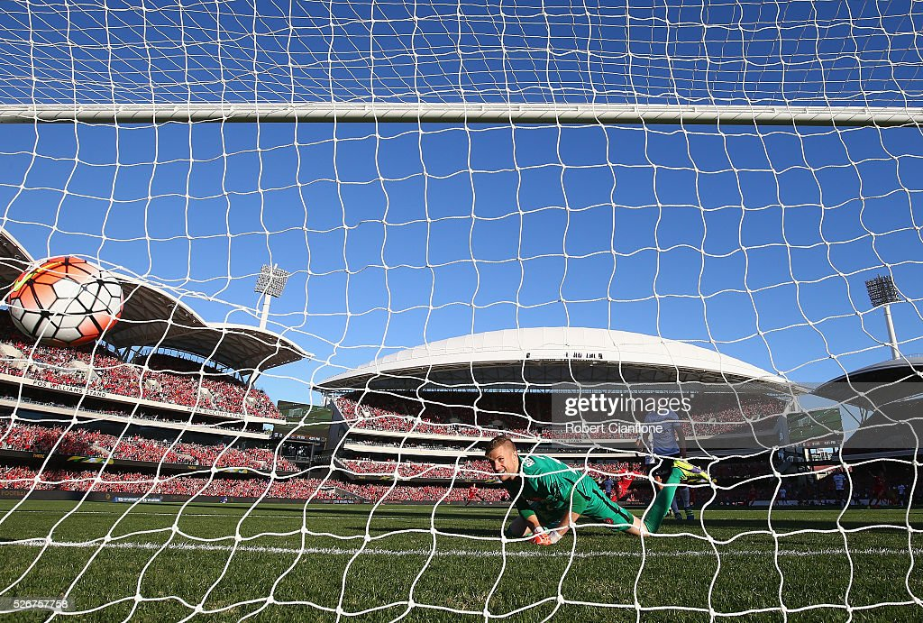 Wanderers goalkeeper Andrew Redmayne is beaten by a shot from Bruce Kamau of Adelaide United during the 2015/16 A-League Grand Final match between Adelaide United and the Western Sydney Wanderers at Adelaide Oval on May 1, 2016 in Adelaide, Australia.