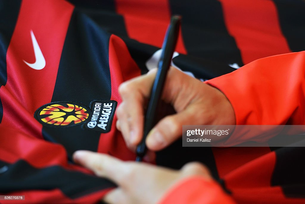 A Wanderers player signs a team shirt during the A-League Grand Final Fan Day at Bonython Park on April 30, 2016 in Adelaide, Australia.