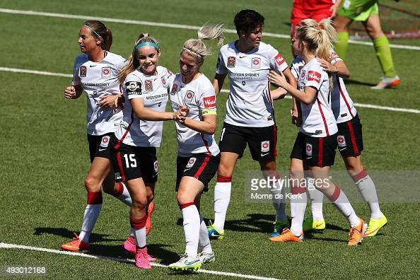 Wanderers players celebrate a goal by Caitlin Cooper during the round one WLeague match between Adelaide United and the Western Sydney Wanderers at...