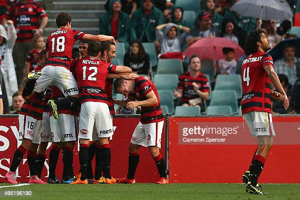 Wanderers players celebrate a goal by Dario Vidosic during the round four ALeague match between the Western Sydney Wanderers and Perth Glory at...