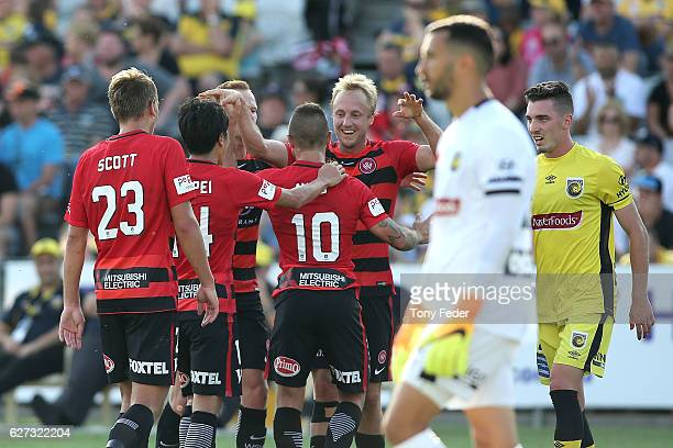 Wanderers players celebrate a goal during the round nine ALeague match between Central Coast Mariners and the Western Sydney Wanderers at Central...