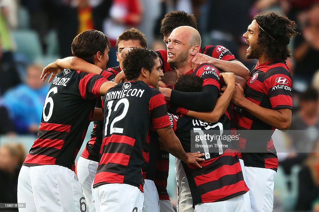 Wanderers players celebrate after a Shinji Ono penalty goal during the round ten A-League match between the Western Sydney Wanderers and the Brisbane Roar at Parramatta Stadium on December 9, 2012 in Sydney, Australia.