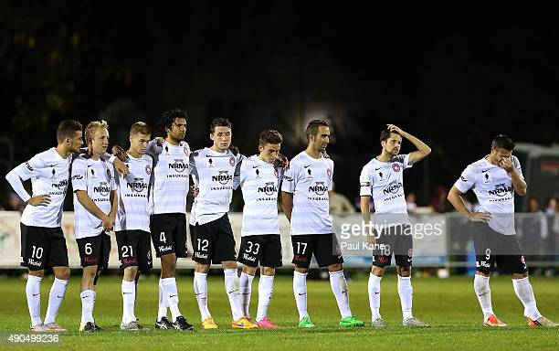 Wanderers players react after a missed penalty shot during the FFA Cup Quarter Final match between the Perth Glory and Western Sydney Wanderers at...