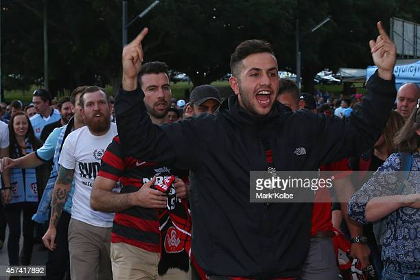 Wanderers supporter gestures to Sydney FC supporters as they enter the ground during the round two ALeague match between Sydney FC and the Western...