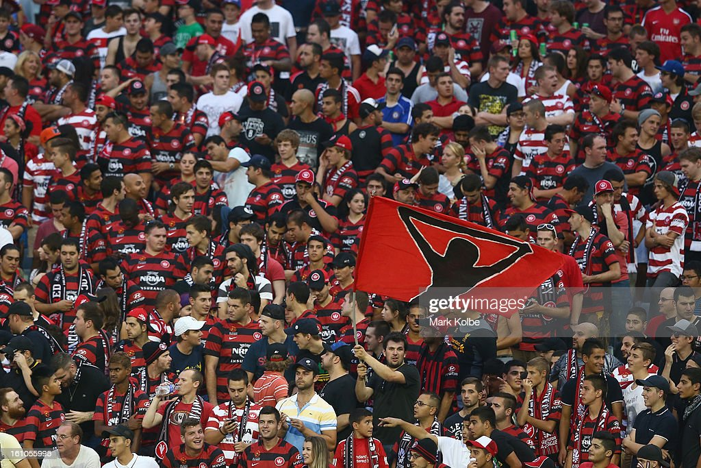 Wanderers supporter waves a flag during warm up for the round 20 A-League match between the Western Sydney Wanderers and the Newcastle Jets at Campbelltown Sports Stadium on February 9, 2013 in Sydney, Australia.