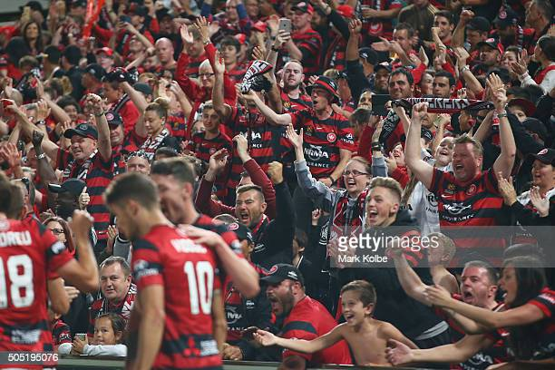 Wanderers supporters cheer as Scott Neville of the Wanderers congratulates Dario Vidosic of the Wanderers as he celebrates scoring a goal during the...