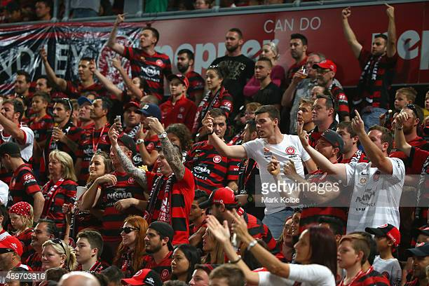 Wanderers supporters gesture to the Sydney FC players after a goal during the round eight ALeague match between Western Sydney Wanderers and Sydney...