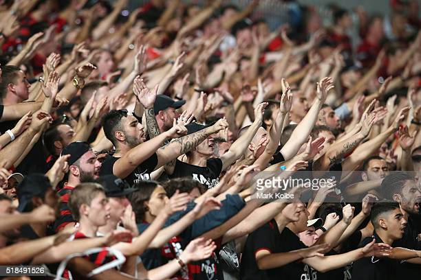 Wanderers supporters in the 'Red and Black Block' cheer during the round 26 ALeague match between the Western Sydney Wanderers and the Central Coast...