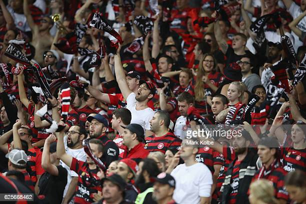 Wanderers supporters in the Red and Black Block cheer during the round eight ALeague match between the Western Sydney Wanderers and the Brisbane Roar...