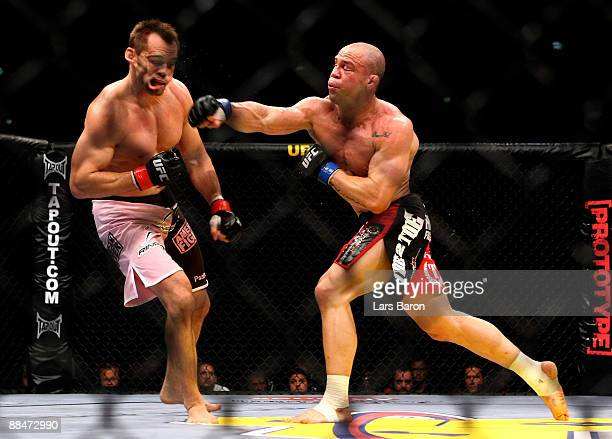 Wanderlei Silva of Brazil hits Rich Franklin of USA during his catchweight bout during the UFC 99 The Comback at Lanxess Arena on June 13 2009 in...