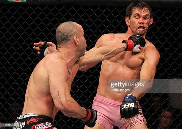 Wanderlei Silva punches Rich Franklin during their UFC 147 catchweight bout at Estadio Jornalista Felipe Drummond on June 23 2012 in Belo Horizonte...
