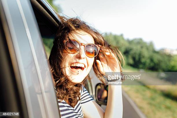 Wanderlust girl traveling by car