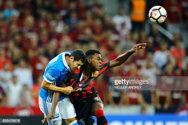 Wanderson from Brazil's Atletico Paranaense struggles for the ball with Pedro Franco of Colombia's Millonarios during a Libertadores Cup football...