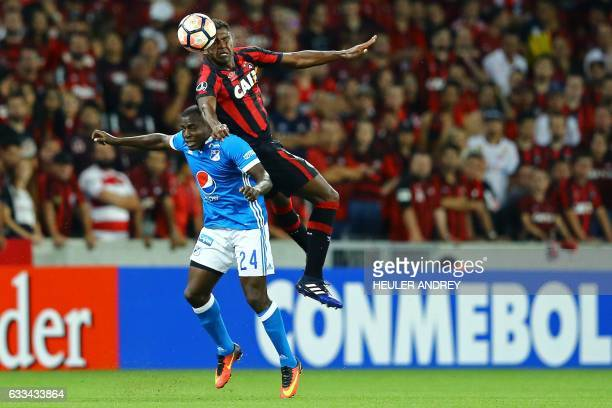 Wanderson from Brazil's Atletico Paranaense struggles for the ball with Eliser Quinonez from Colombia's Millonarios during a Libertadores Cup...
