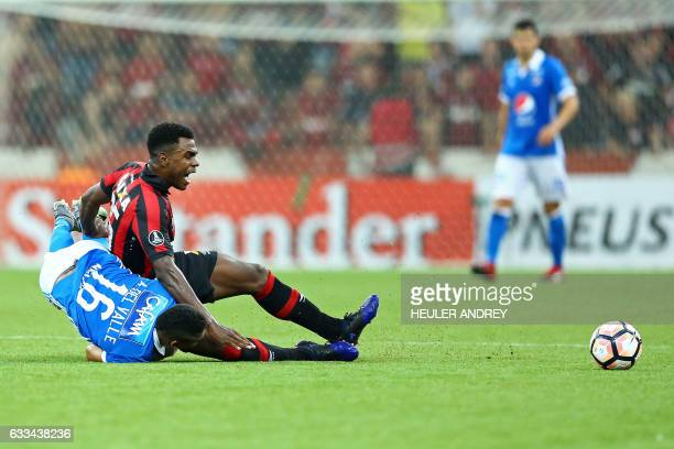 Wanderson from Brazil's Atletico Paranaense struggles for the ball with Ayron Del Valle of Colombia's Millonarios during a Libertadores Cup football...