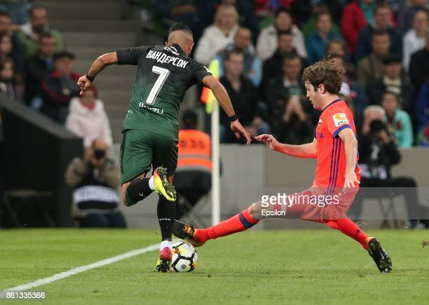 Wanderson of FC Krasnodar is challenged by Mario Fernandes of FC CSKA Moscow during the Russian Premier League match between FC Krasnodar v FC CSKA...