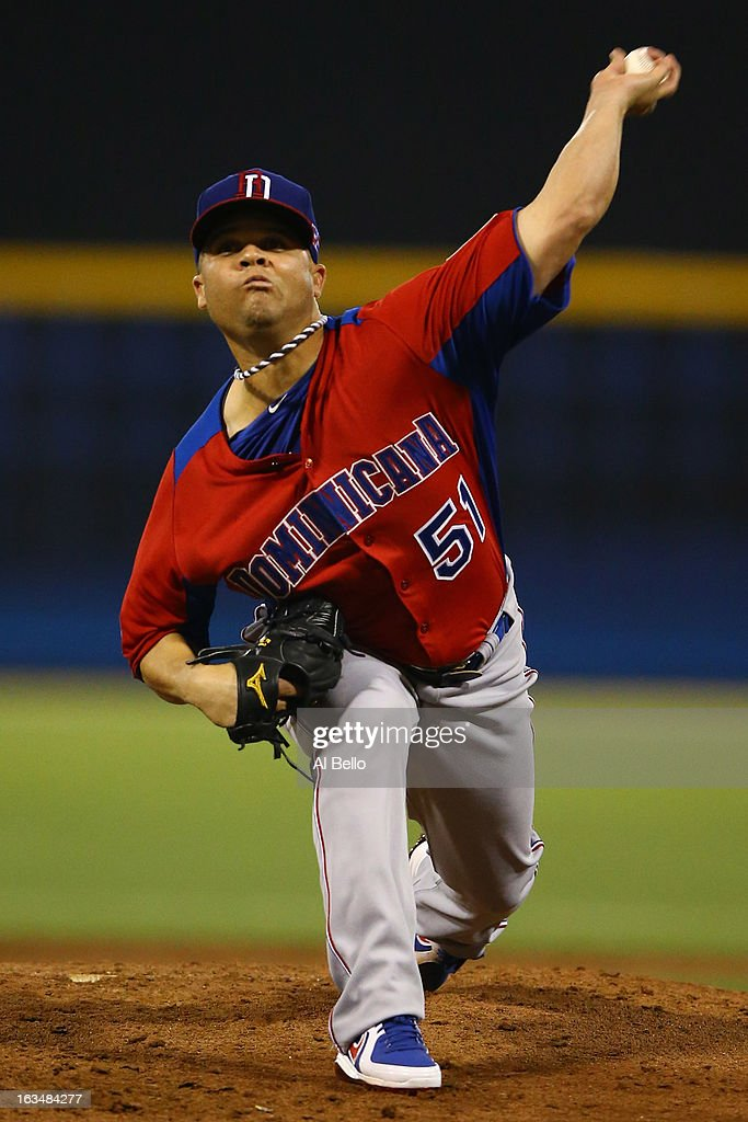 <a gi-track='captionPersonalityLinkClicked' href=/galleries/search?phrase=Wandy+Rodriguez&family=editorial&specificpeople=247781 ng-click='$event.stopPropagation()'>Wandy Rodriguez</a> #51 of the Dominican Republic pitches against Puerto Rico during the first round of the World Baseball Classic at Hiram Bithorn Stadium on March 10, 2013 in San Juan, Puerto Rico.