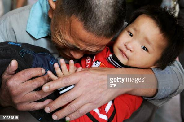 Wang Bangyin breaks down as he hugs his rescued son at Guiyang Welfare Center for Children in Guiyang southwest China's Guizhou province on October...
