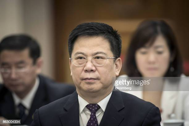 Wang Bin chairman of China Pacific Insurance Corp attends a delegation meeting at the Great Hall of the People during the 19th National Congress of...