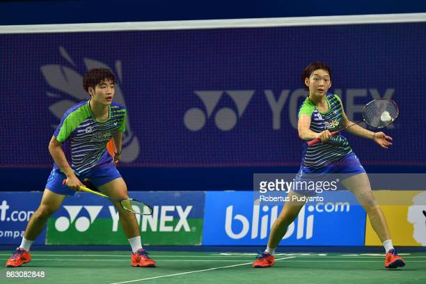 Wang Chan and Kim Min Ji of Korea compete against Shiwen Liu and Li Wenmei of China during Mixed Doubles Round 16 match of the BWF World Junior...