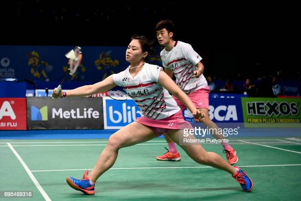 Wang ChiLin and Lee Chia Hsin of Chinese Taipei compete against Hafiz Faizal and Shela Devi Aulia of Indonesia during Mixed Doubles Round 1 match of...