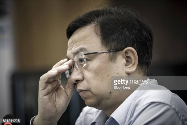Wang Chuanfu chairman of BYD Co adjusts his glasses during a news conference at the company's headquarters in Shenzhen China on Thursday Sept 21 2017...