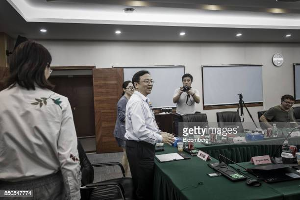 Wang Chuanfu chairman of BYD Co center arrives for a news conference at the company's headquarters in Shenzhen China on Thursday Sept 21 2017 China...