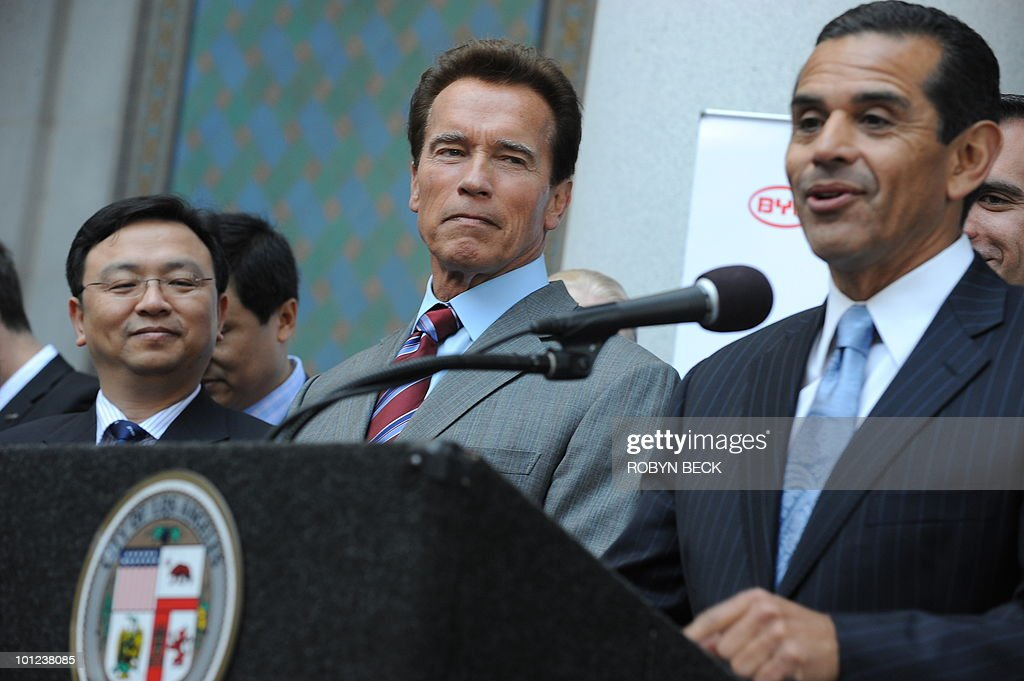 Wang Chuanfu (L), chairman of Chinese alternative-energy auto maker BYD, and California Governor Arnold Schwarzenegger (C) look on as Los Angeles Mayor Antonio Villaraigosa speaks at a press conference April 30, 2010 at City Hall in Los Angeles,CA to announce that the Chinese solar energy and automobile firm will locate its US headquarters in Los Angeles, potentially creating hundreds of new jobs. BYD, which stands for Build Your Dreams, is a manufacturer of batteries, solar panels and electric-hybrid vehicles partly financed by billionaire Warren Buffett.