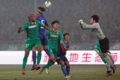 Wang Dalei of Shanghai Shenhua makes a save from Australia International player Da Costa Reinaldo Elias of Beijing Guoan during the Chinese Super...