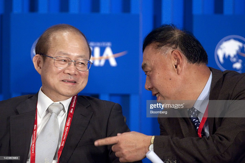 Wang Dongming, chairman of Citic Securities Co. Ltd., right, speaks with Schive Chi, chairman of the Taiwan Stock Exchange Corp., during a session at the Boao Forum for Asia in Boao, Hainan Province, China, on Tuesday, April 3, 2012. The Boao Forum ends today. Photographer: Nelson Ching/Bloomberg via Getty Images
