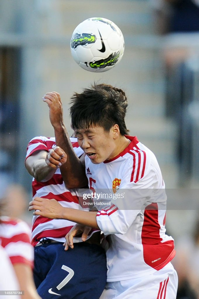 Wang Dongni #5 of China heads the ball in front of Shannon Boxx #7 of the USA at PPL Park on May 27, 2012 in Chester, Pennsylvania.
