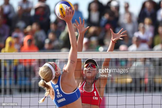 Wang Fan of China in action with Xia Xinyi of China during the match against Brooke Sweat and Summer Ross of the United States on Day 5 of FIVB Beach...