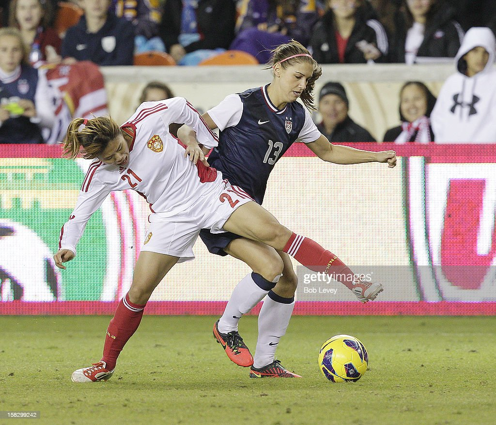 Wang Fei (21) of China battles with Alex Morgan (13) of the United States in the second half at BBVA Compass Stadium on December 12, 2012 in Houston, Texas. USA won 4-0.