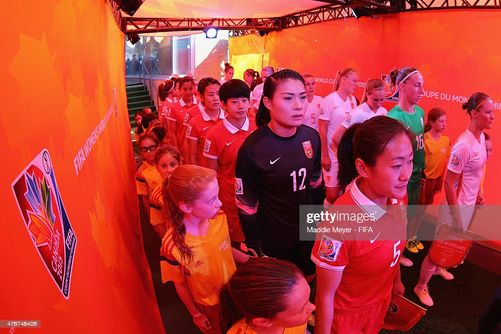 Wang Fei of China PR and her team prepare to enter the pitch before the FIFA Women's World Cup Canada 2015 Group A Match against the Netherlands at...