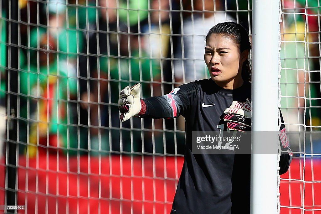 Wang Fei of China PR directs her defence during the FIFA Women's World Cup 2015 Round of 16 match between China PR and Cameroon at Commonwealth...