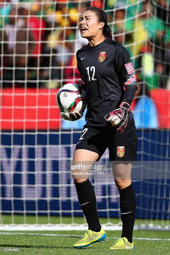 Wang Fei of China PR directs her team during the FIFA Women's World Cup 2015 Round of 16 match between China PR and Cameroon at Commonwealth Stadium...