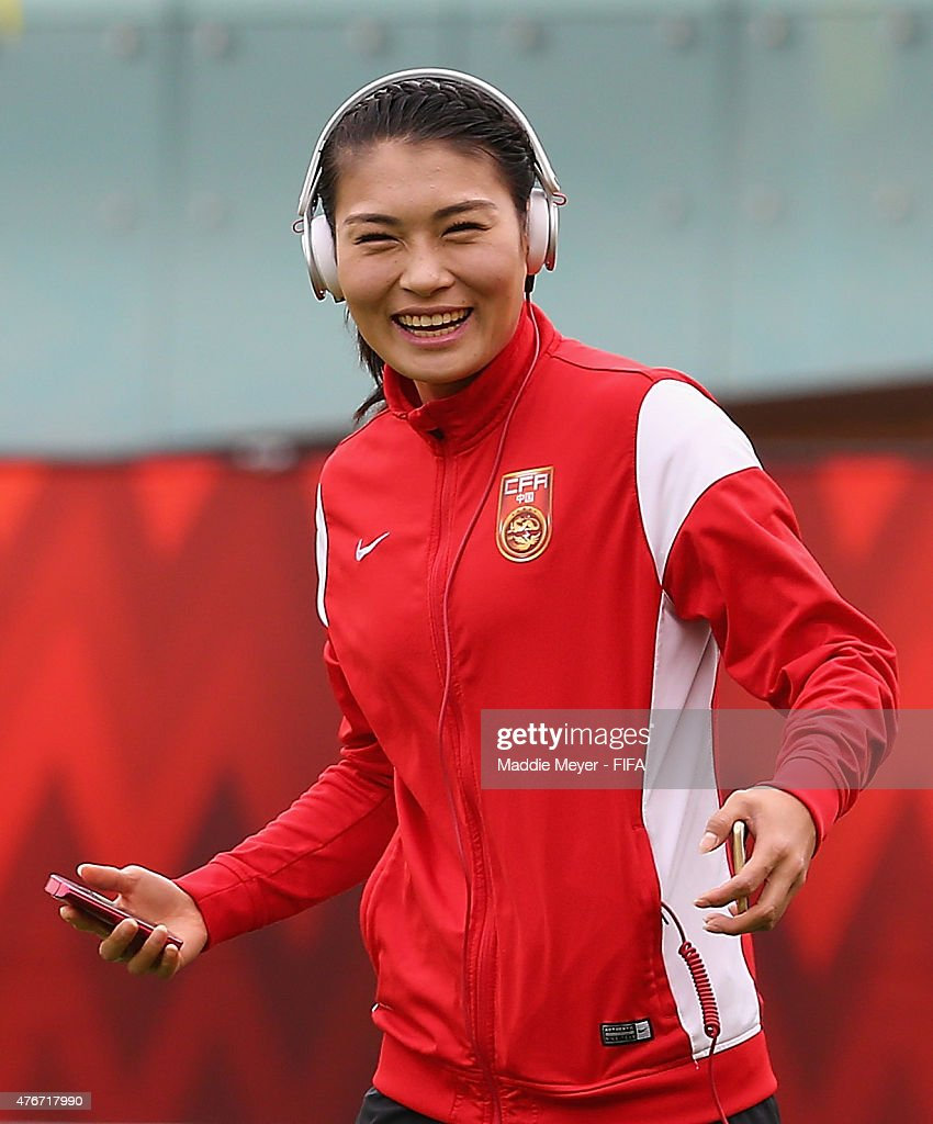 Wang Fei of China PR laughs on the field before the FIFA Women's World Cup Canada 2015 Group A Match at Commonwealth Stadium on June 11 2015 in...