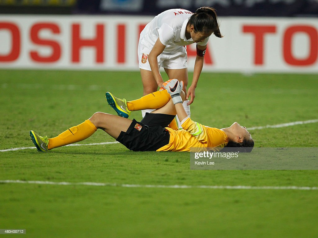 Wang Fei of China PR lies on the ground after a collision at EAFF East Asian Cup 2015 final round between China PR and Japan at the Wuhan Sports...