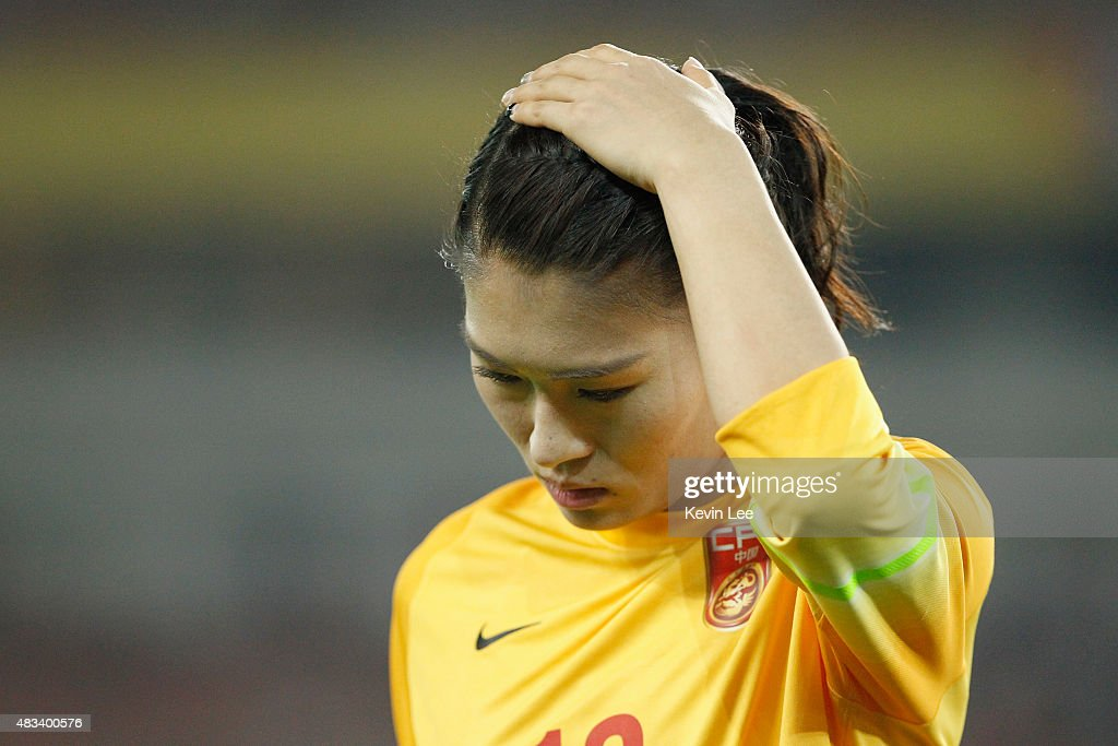 Wang Fei of China PR looks dejected after she fails to stop a goal at EAFF East Asian Cup 2015 final round against Japan at the Wuhan Sports Center...