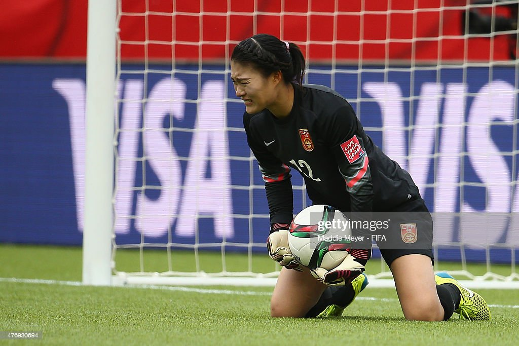Wang Fei of China PR makes a save during the FIFA Women's World Cup Canada 2015 Group A Match against the Netherlands at Commonwealth Stadium on June...