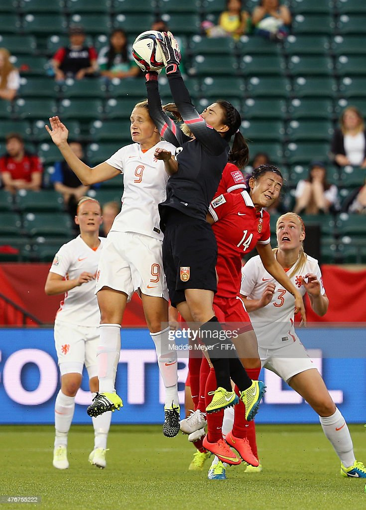 Wang Fei of China PR makes a save over Vivianne Miedema of Netherlands during the FIFA Women's World Cup Canada 2015 Group A Match at Commonwealth...
