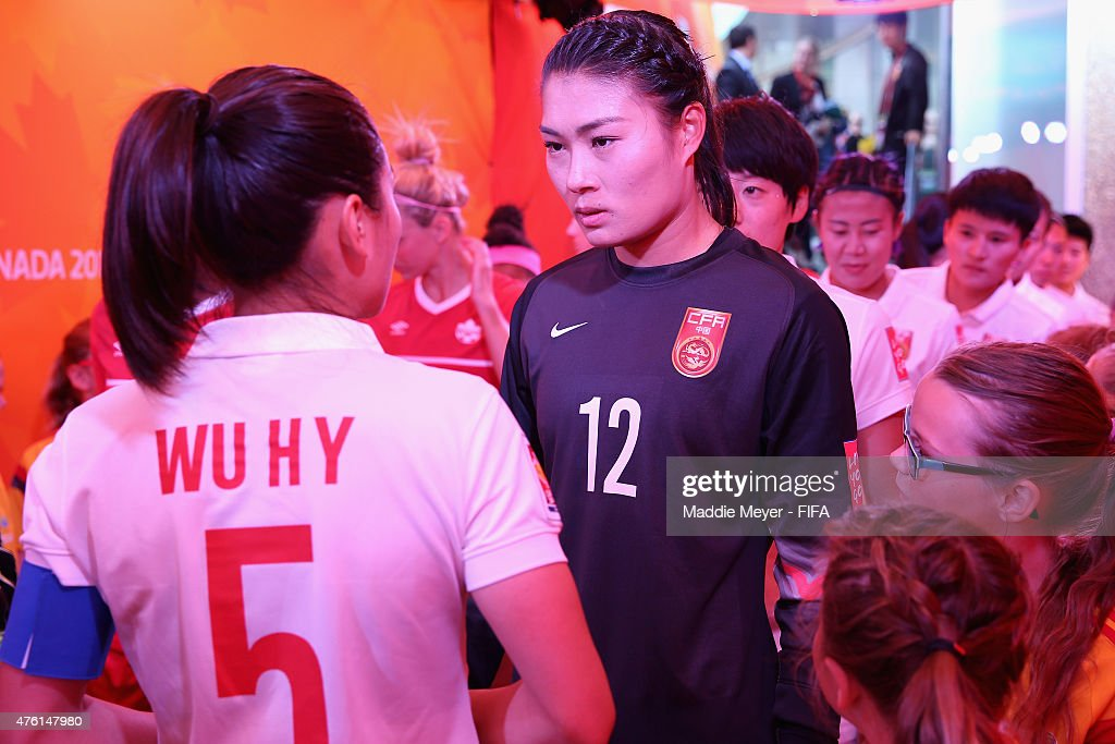 Wang Fei of China PR talks with Wu Haiyan in the tunnel before the FIFA Women's World Cup Canada 2015 Group A match between Canada and China PR at...