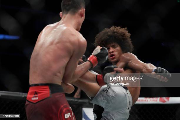 Wang Guan fights with Alex Caceres during the UFC Fight Night at MercedesBenz Arena on November 25 2017 in Shanghai China