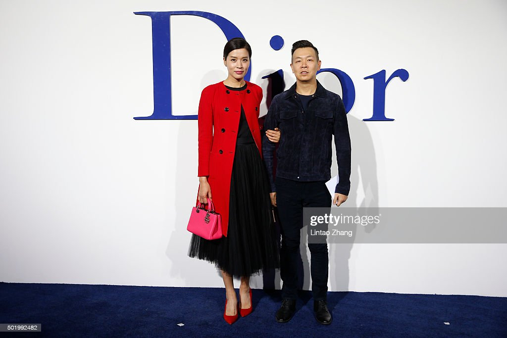 Wang Haizhen and Zhang Yong arrive at Dior SS 2016 Repeat Show at the Phoenix International Media Center on December 19 2015 in Beijing China