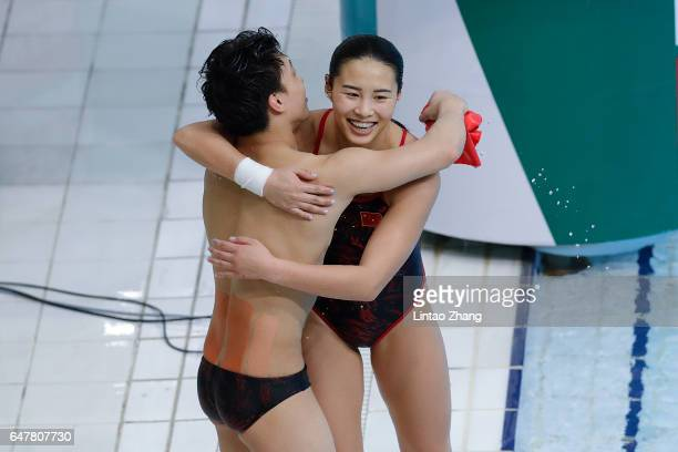 Wang Han and Li Zheng of China celebrate after competing in the Mixed 3m Synchro Springboard final on day two of the FINA/NVC Diving World Series...