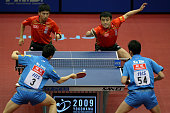Wang Hao and Chen Qi of China compete in the Men's Doubles final match against Ma Long and Xu Xin of China during the World Table Tennis...