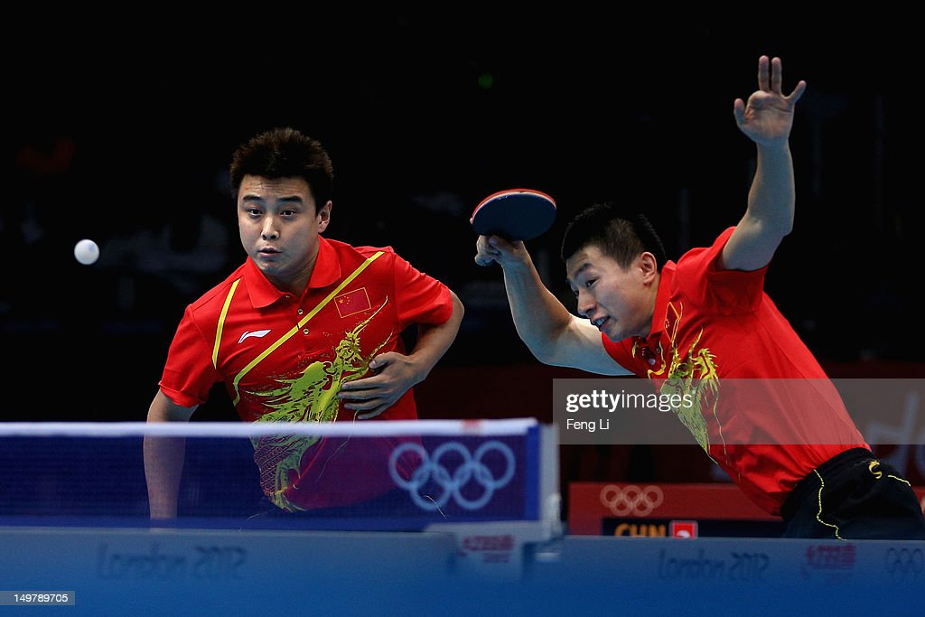 Wang Hao and Ma Long of China complete during Men's Team Table Tennis first round match against team of Russia on Day 8 of the London 2012 Olympic...