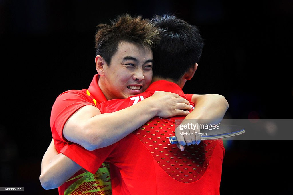 Wang Hao and Zhang Jike of China celebrate defeating Seungmin Ryu and Sang Eun Oh of Korea 3-0 and winning the Men's Team Table Tennis gold medal match on Day 12 of the London 2012 Olympic Games at ExCeL on August 8, 2012 in London, England.