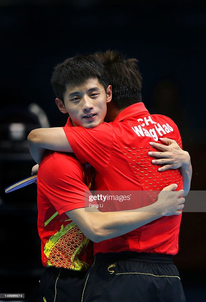 Wang Hao (R) and Zhang Jike (L) of China celebrate defeating Seungmin Ryu and Sang Eun Oh of Korea 3-0 and winning the Men's Team Table Tennis gold medal match on Day 12 of the London 2012 Olympic Games at ExCeL on August 8, 2012 in London, England.