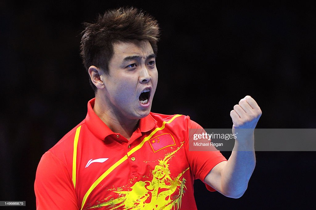 Wang Hao celebrates defeating Seungmin Ryu and Sang Eun Oh of Korea 3-0 with playing partner Zhang Jike of China and winning the Men's Team Table Tennis gold medal match on Day 12 of the London 2012 Olympic Games at ExCeL on August 8, 2012 in London, England.